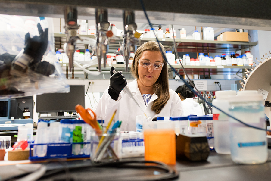 Ph.D. candidate Angela Wagner uses a pipette inside a biomedical engineering lab.