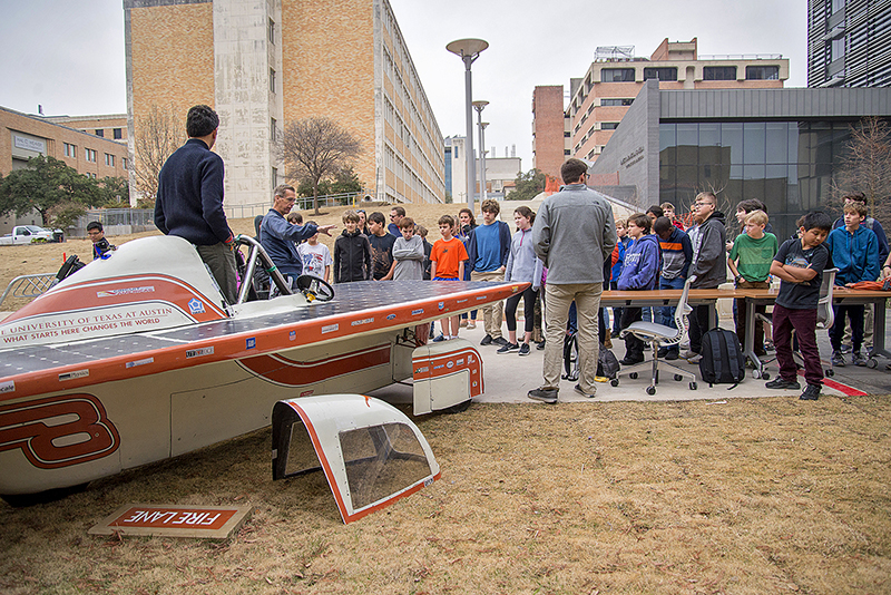 Children look at a solar car built by UT students during the 2018 Edison Lecture.