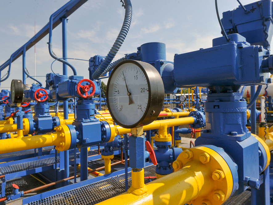 close-up photo of blue and yellow pipes and valves