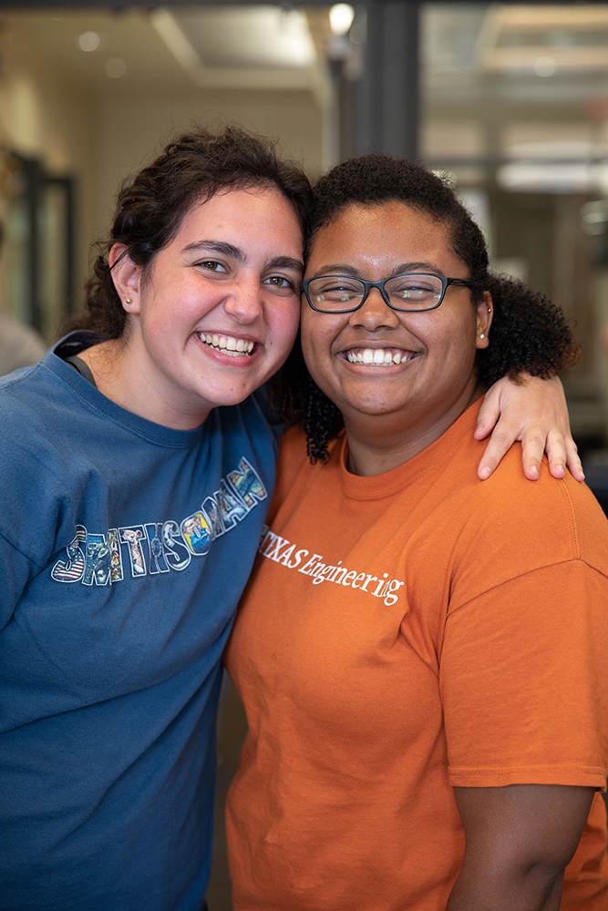 Two students smile at the biomedical engineering fall gathering
