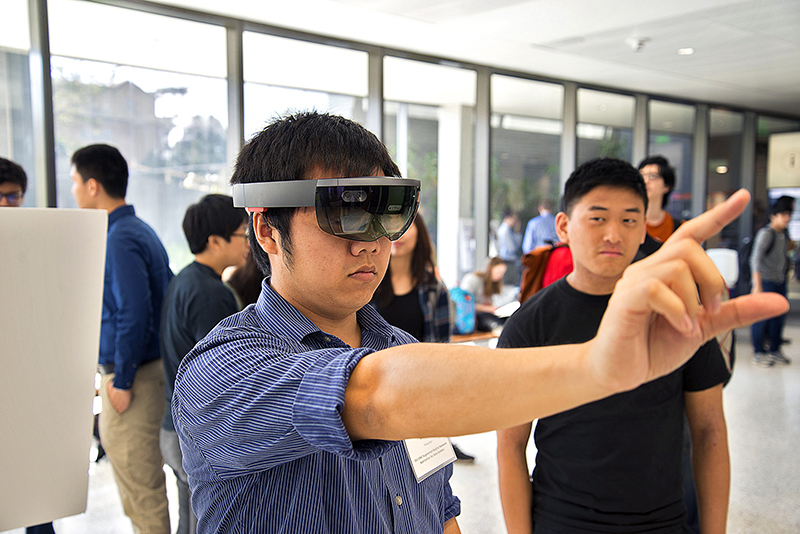 A student uses VR glasses during the Electrical and Computer Engineering Capstone Design Showcase.