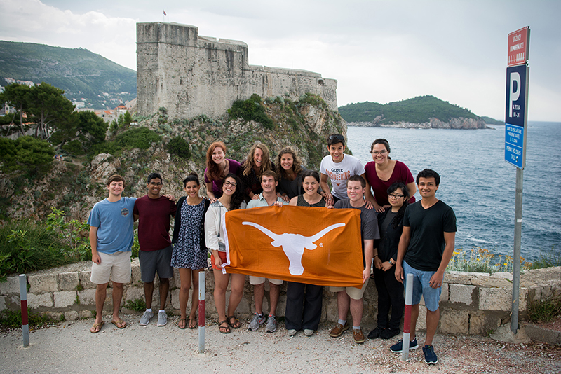Students pose with a longhorn flag in Croatia.