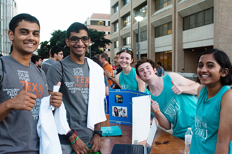 Students from different student organizations smile and pose at outside at the Gone to Engineering event