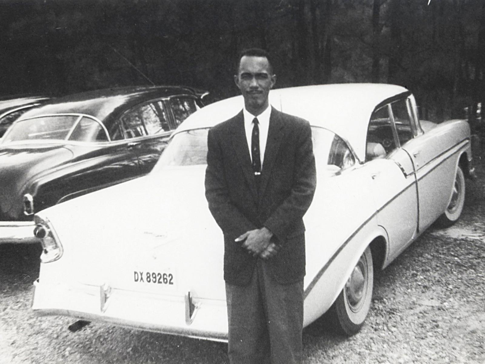 Ervin Perry in front of car