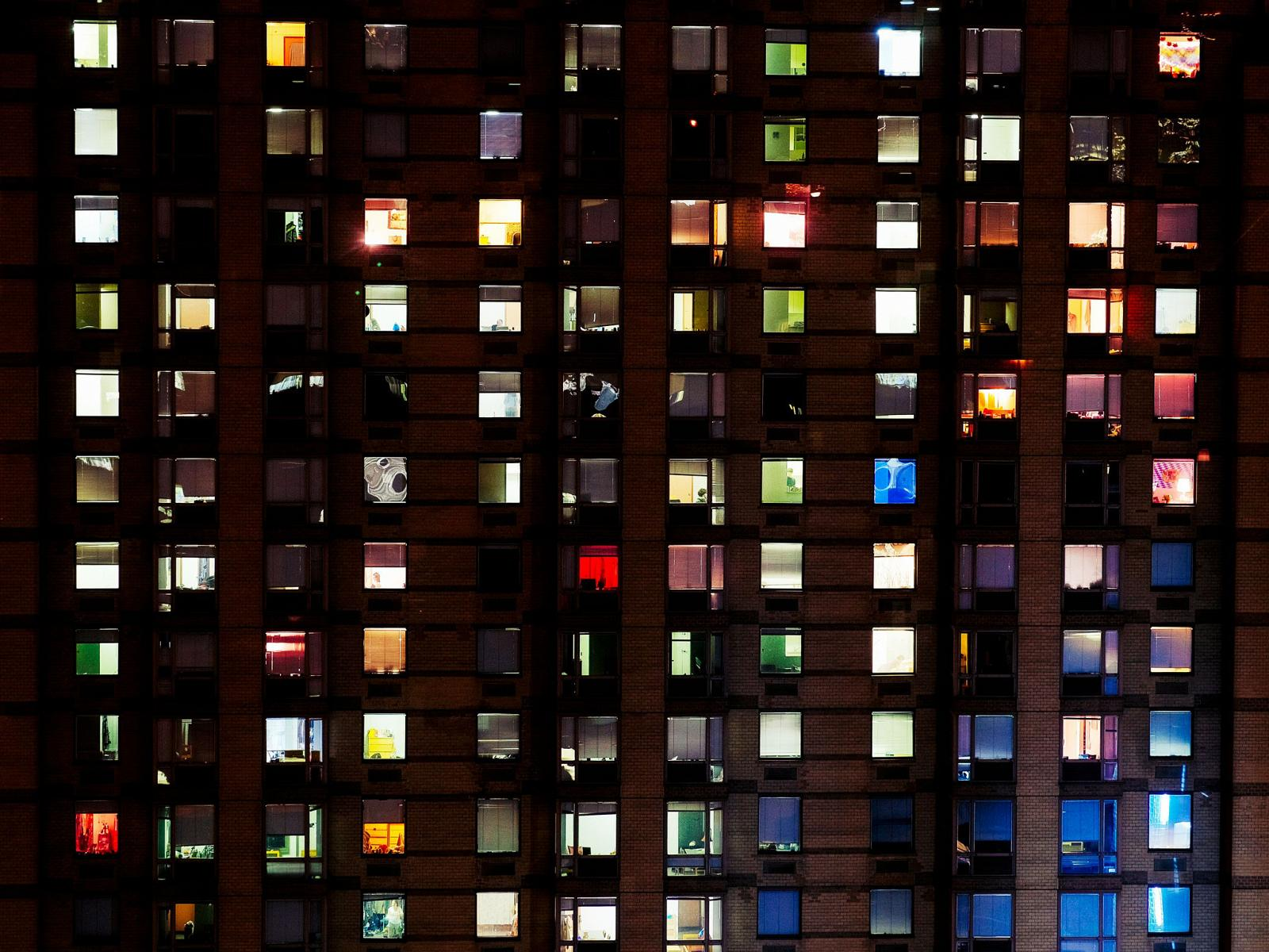 grid of backlit windows in large building