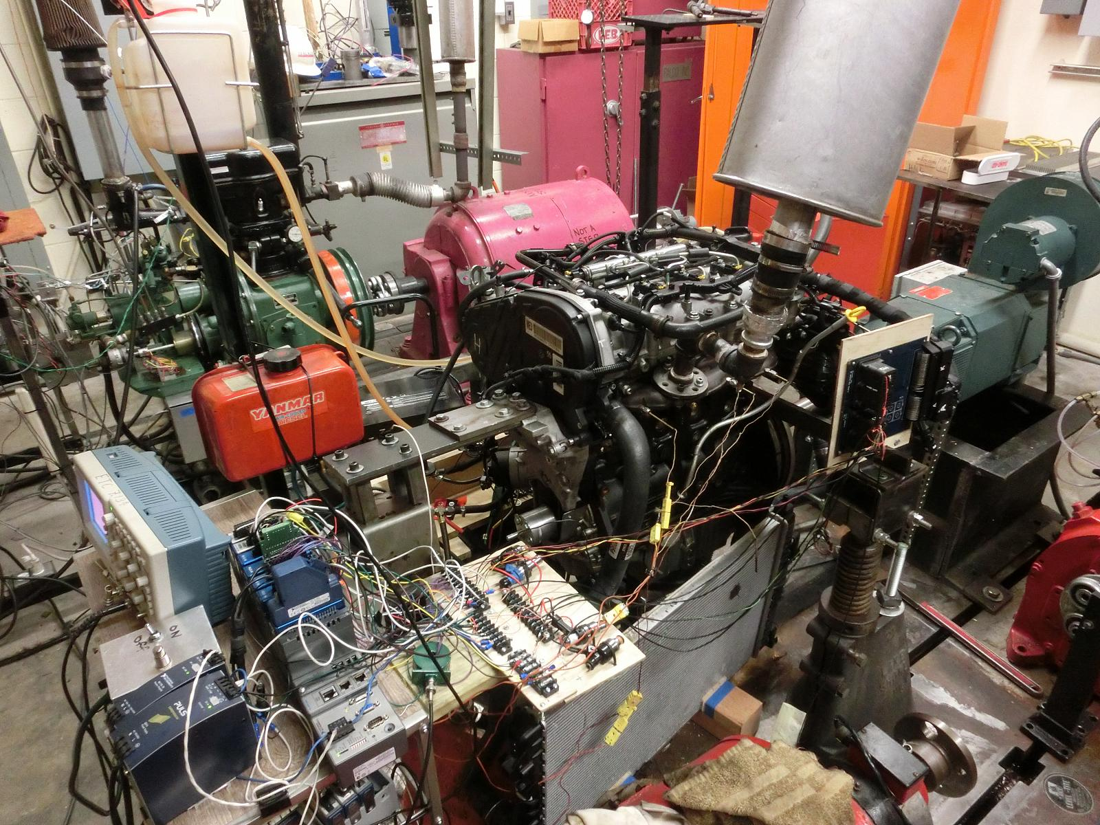 large machine diesel engine inside of a lab