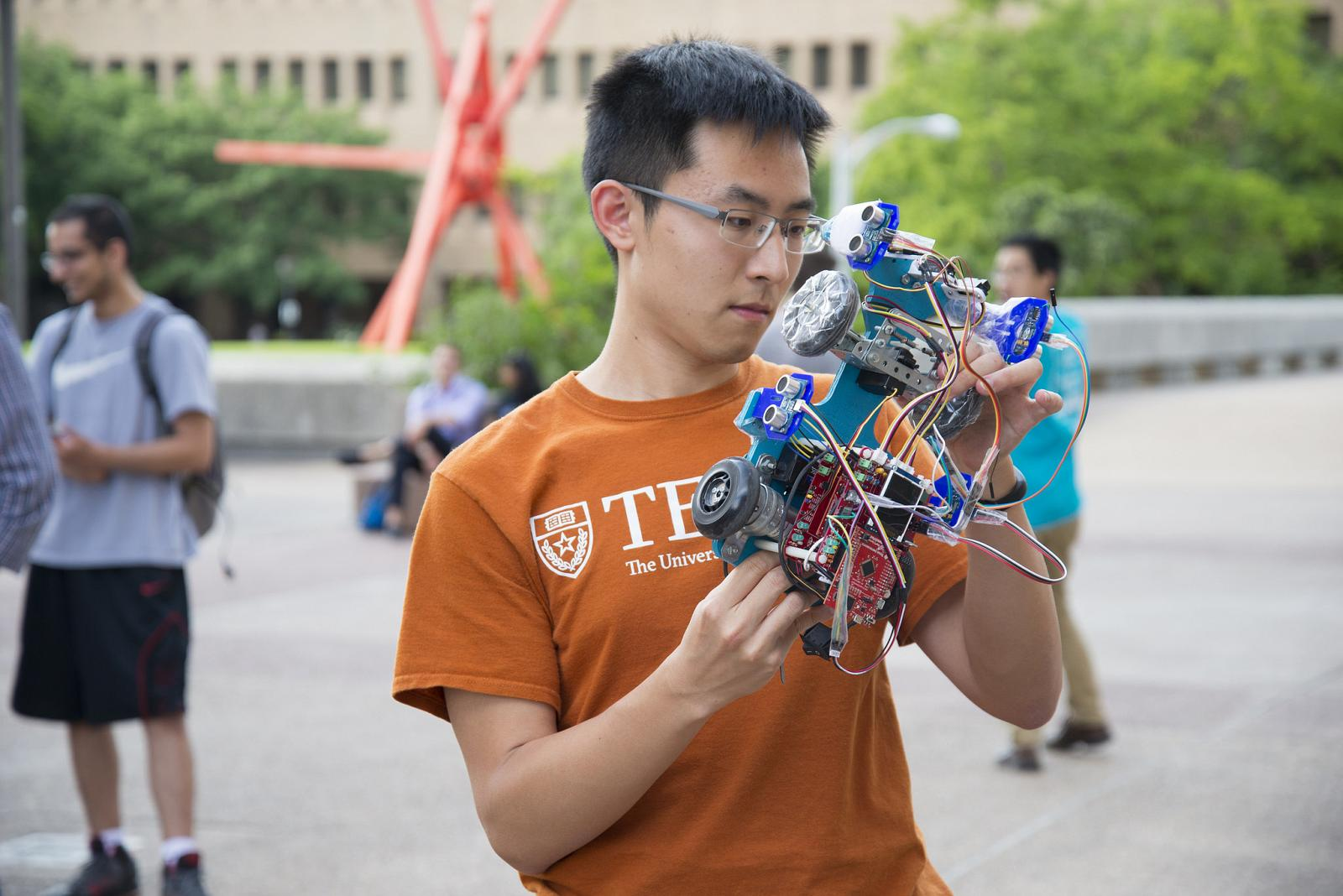 student with robotic car