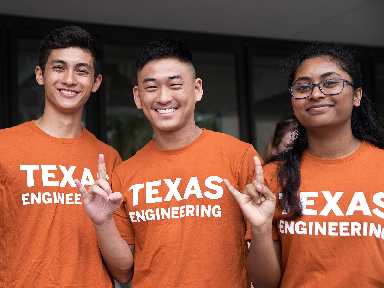 students smiling and wearing texas engineering shirts